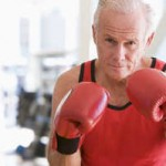 older-Man-Boxing-At-Gym-500w-300x199